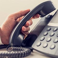 Hand Picking Up Phone Handset