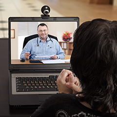 Medical Professional on computer screen